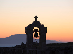 Silhouette of church bell-tower within the Fortezza, sunset, Rethymno (Rethymnon), Crete, Greek Islaの写真素材 [FYI03798044]
