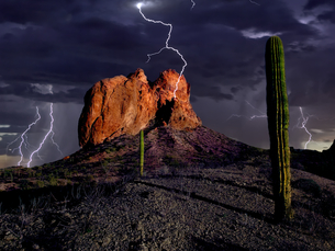 An HDR composite of lightning striking Courthouse Rock in the Eagletail Wilderness of western Arizonの写真素材 [FYI03798110]
