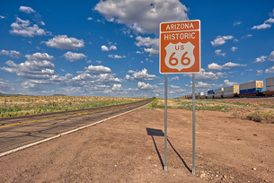 Road sign marking Historic Route 66 just east of Seligman, the birthplace of the famous road, Arizonの写真素材 [FYI03798136]