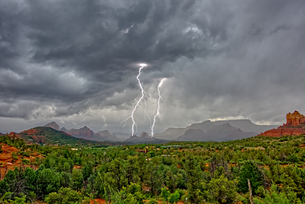 Lightning striking during a storm over Cibola Rock in Uptown, viewed from the Broken Arrow Trail, Seの写真素材 [FYI03798233]