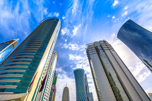 Low angle view of Al Fardan Towers complex and Doha Tower, iconic glassed high rises in West Bay, Doの写真素材 [FYI03798257]