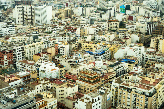 Aerial cityscape, patterned abstract of numerous white and yellow modern buildings, Casablanca, Moroの写真素材 [FYI03798548]