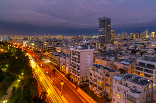 Elevated view of trail lights and Tel Aviv skyline at dusk, Jaffa visible in the background, Tel Aviの写真素材 [FYI03799501]