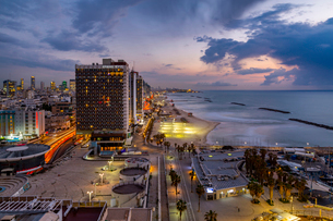 Elevated view of the beaches and hotels at dusk, Jaffa visible in the background, Tel Aviv, Israel,の写真素材 [FYI03799503]
