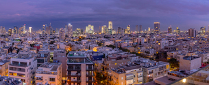 Elevated view of Tel Aviv skyline at dusk, Jaffa visible in the background, Tel Aviv, Israel, Middleの写真素材 [FYI03799506]
