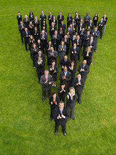 Group of business people standing in triangle formationの写真素材 [FYI03800703]