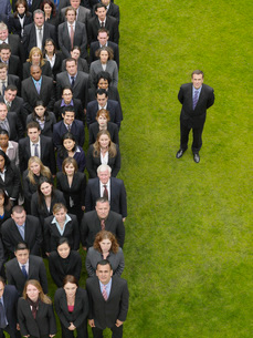 Business man standing next to large group of peopleの写真素材 [FYI03800712]
