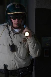 Nightwatch patrolman with flashlightの写真素材 [FYI03800767]