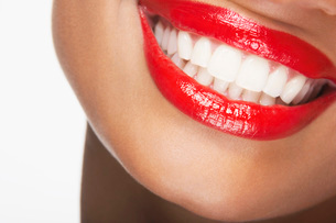 Mouth with red lipstick smilingの写真素材 [FYI03800818]