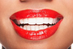 Woman's teeth and mouth with red lipstickの写真素材 [FYI03800819]