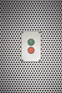Red and green buttons on silver backgroundの写真素材 [FYI03800829]