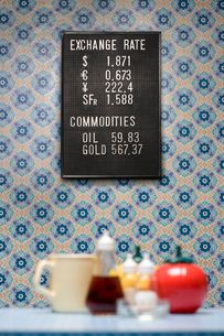 Trading board on wall with wallpaper containers and mug seleの写真素材 [FYI03800835]