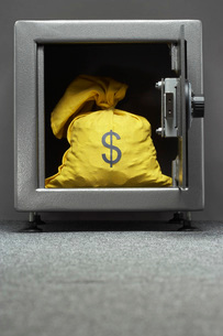 Sack with dollar symbol in safeの写真素材 [FYI03800838]
