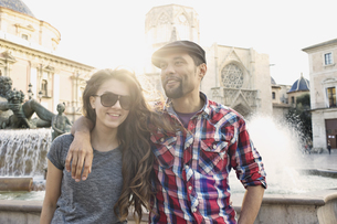 Tourist couple posing, Plaza de la Virgen, Valencia, Spainの写真素材 [FYI03802250]