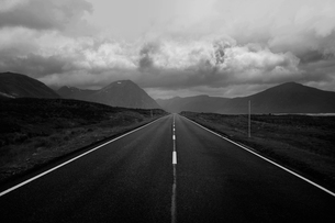 Black and white image of straight road and mountains, Scottish Highlands, Scotlandの写真素材 [FYI03802615]