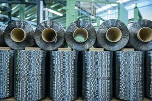 Rows of carbon fibre in carbon fibre factoryの写真素材 [FYI03802783]