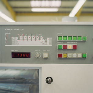 Close up detail of printing machine in printworksの写真素材 [FYI03802954]