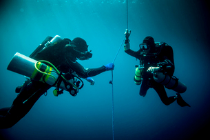 Underwater view of two technical divers using rebreathers device to locate shipwreck, Lombok, Indoneの写真素材 [FYI03804013]