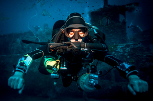Underwater portrait of technical diver using a rebreather device to locate shipwreck, Lombok, Indoneの写真素材 [FYI03804024]