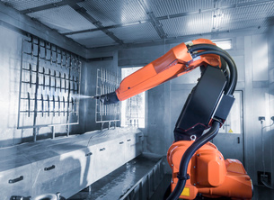 Robot spray painting automotive parts in spray paint factoryの写真素材 [FYI03804106]