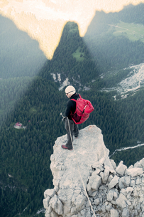 BASE jumper checking the exit spot at Torre Trieste, Italian Alps, Alleghe, Belluno, Italyの写真素材 [FYI03805001]