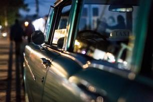 Close up of vintage car on roadside at dusk, Vinales, Cubaの写真素材 [FYI03806009]