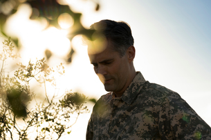 Portrait of soldier wearing combat clothing looking down, Runyon Canyon, Los Angeles, California, USの写真素材 [FYI03806057]