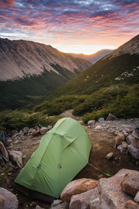 Tent at mountain landscape at sunrise, Nahuel Huapi National Park, Rio Negro, Argentinaの写真素材 [FYI03806380]