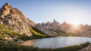 Sunlit landscape view of mountains and Tonchek lake, Nahuel Huapi National Park, Rio Negro, Argentinの写真素材 [FYI03806384]