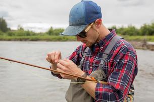 Man preparing bait in river, Clark Fork, Montana and Idaho, USの写真素材 [FYI03806438]