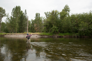 Man fishing in river, Clark Fork, Montana and Idaho, USの写真素材 [FYI03806442]