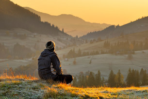 Man alone at sunrise, Krasnik village area, Carpathian Mountの写真素材 [FYI03807270]