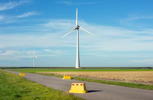 Road block near modern wind turbines on and offshore, Creil, Flevoland, Netherlandsの写真素材 [FYI03807280]