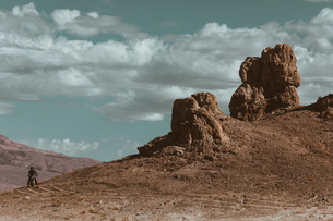 Motorcyclist riding in desert, Trona Pinnacles, California, USの写真素材 [FYI03807306]