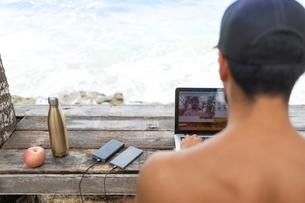 Man on video call on laptop, Pagudpud, Ilocos Norte, Philippinesの写真素材 [FYI03807358]