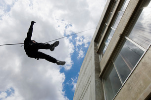 SWAT Team Officer Rappelling from Buildingの写真素材 [FYI03807849]