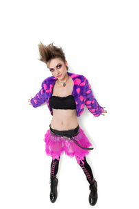 Portrait of beautiful young woman with spiked hair over whitの写真素材 [FYI03807923]