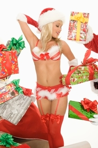 Mrs Claus in underwear surrounded by giftsの写真素材 [FYI03807994]