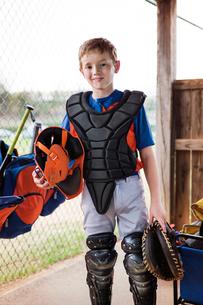 Portrait of confident baseball catcher at fieldの写真素材 [FYI03808814]