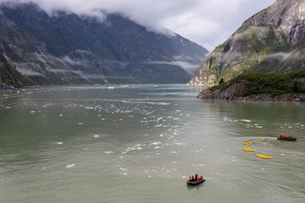 Kayak expedition preparations, Tracy Arm Fjord, clearing mist, icebergs and cascades, near South Sawの写真素材 [FYI03812613]