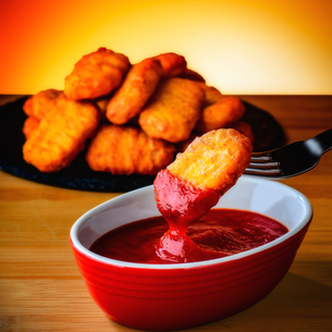 Chicken nugget on forkの写真素材 [FYI03817479]