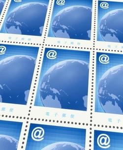 アットマークと地球のデザインの切手シート(青)のイラスト素材 [FYI03831775]