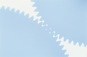 歯車のアップ(水色)の写真素材 [FYI03831999]