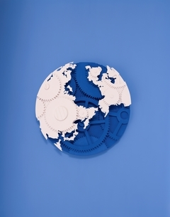 歯車でできている地球の半立体クラフトの写真素材 [FYI03838727]
