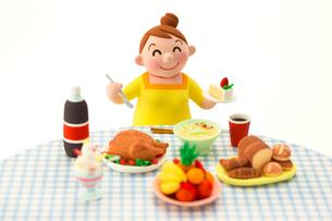 大食いのメタボな女性の写真素材 [FYI03948275]