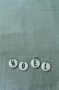 NOELと置かれたコースターの写真素材 [FYI03954297]