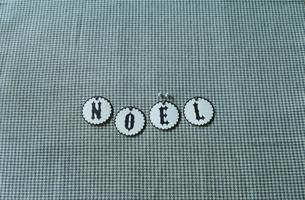 NOELと置かれたコースターの写真素材 [FYI03954298]