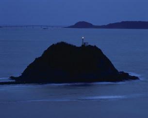 落日の灯台の写真素材 [FYI04023849]
