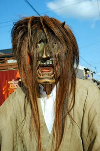 上野天神祭 鬼行列・蛇(じゃ)面の写真素材 [FYI04079107]