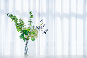 Bouquet in vase decorated near white curtain.  Modern lifestyle concept.の写真素材 [FYI04085272]